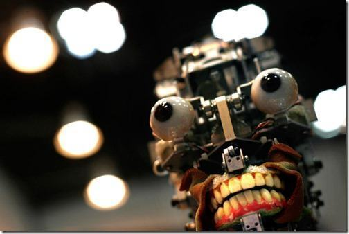 """A humanoid robot, without its facial skin, is displayed at Japan's largest robot convention in Tokyo Wednesday Nov. 28, 2007. The life-size dental training robot, dubbed Simroid for """"simulator humanoid,"""" has realistic skin, eyes, and a mouth that can be fitted with replica teeth that trainees practice drilling on and cries in pain when the drilling goes wrong. (AP Photo/David Guttenfelder)"""