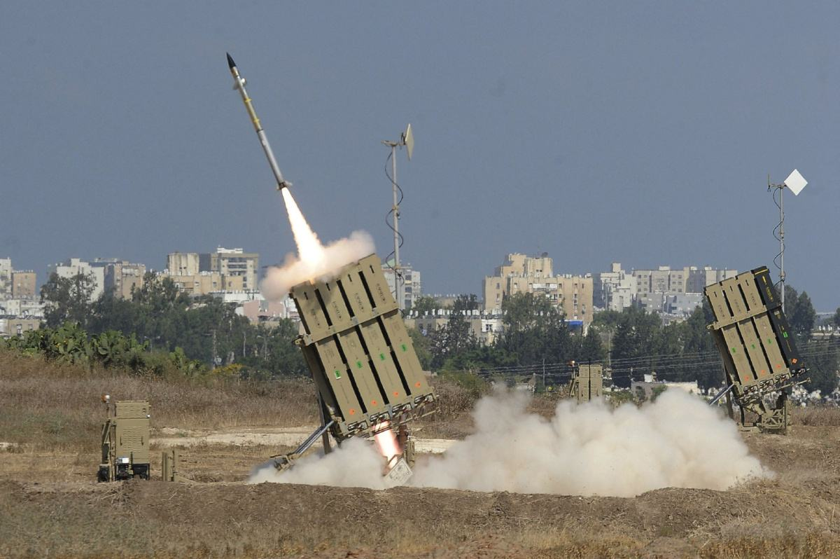 """TOPSHOTS TOPSHOTS A missile is launched by an """"Iron Dome"""" battery, a short-range missile defence system designed to intercept and destroy incoming short-range rockets and artillery shells, on July 9, 2014 in the southern Israeli city of Ashdod, neighboring the Gaza Strip. The Israeli air force bombed 160 targets in the Gaza Strip overnight as it pressed a widescale campaign to stop volleys of Palestinian rocket fire, an army official said. AFP PHOTO/DAVID BUIMOVITCHDAVID BUIMOVITCH/AFP/Getty Images"""