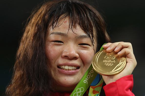 RIO DE JANEIRO, BRAZIL - AUGUST 18: Gold medalist Risako Kawai of Japan celebrates during the medal ceremony following the Women's Freestyle 63 kg competition on Day 13 of the Rio 2016 Olympic Games at Carioca Arena 2 on August 18, 2016 in Rio de Janeiro, Brazil. (Photo by Julian Finney/Getty Images)