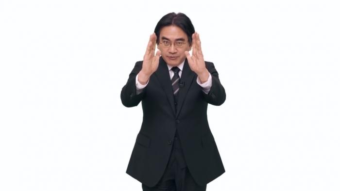 Satoru Iwata com seu típico movimento de mãos